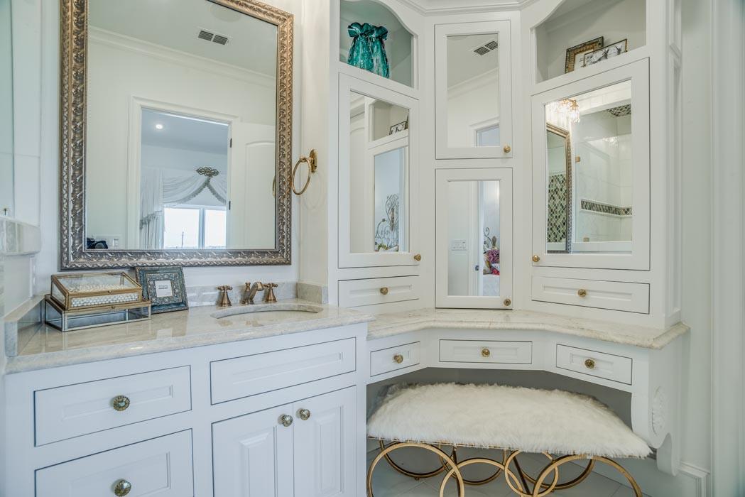 Bath in custom home featuring corner dressing vanity.