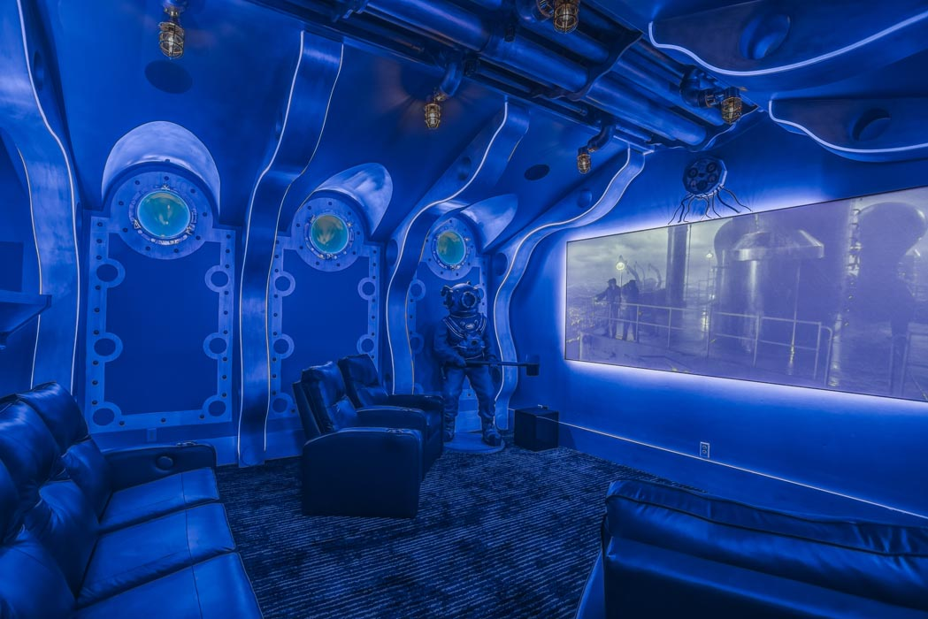 View of amazing home theatre room, with specialty nautical theme and lighting effects.
