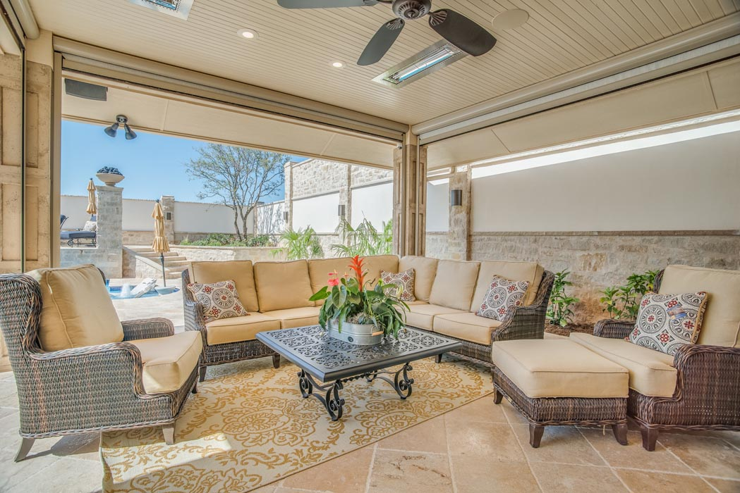 Covered patio area of spacious back lawn of custom home in Lubbock.