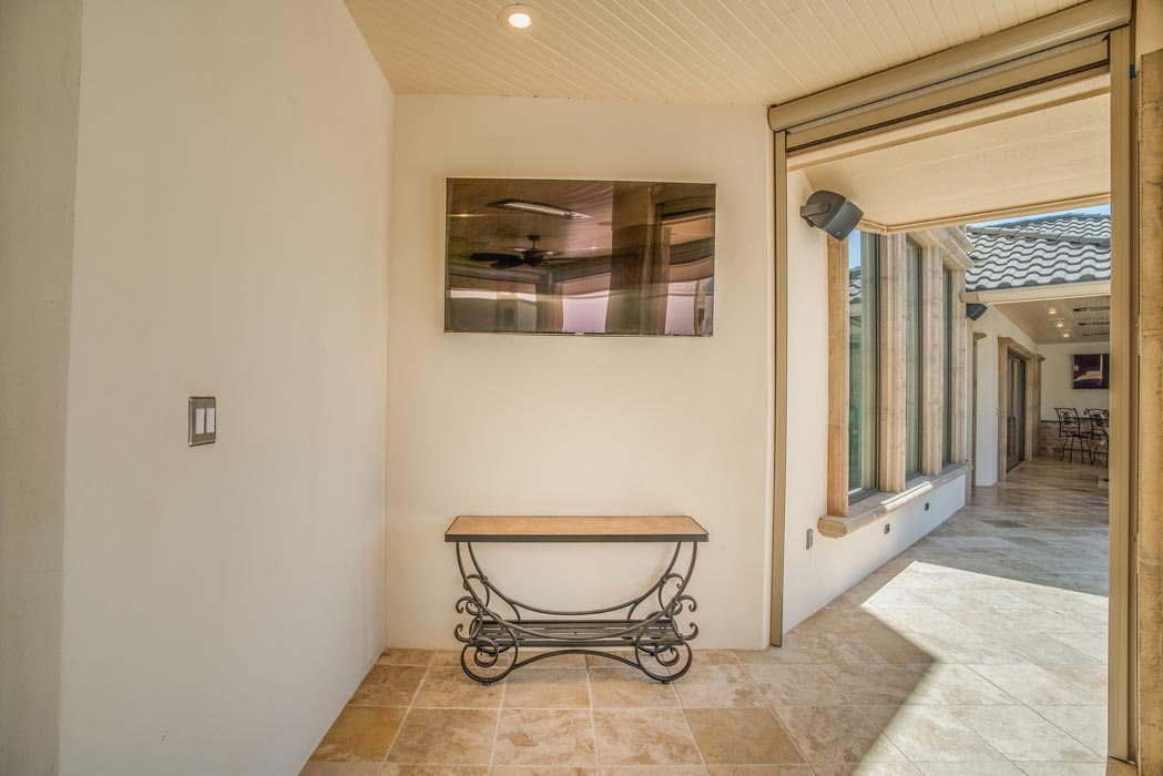 Hall area of outdoor patio in custom home.