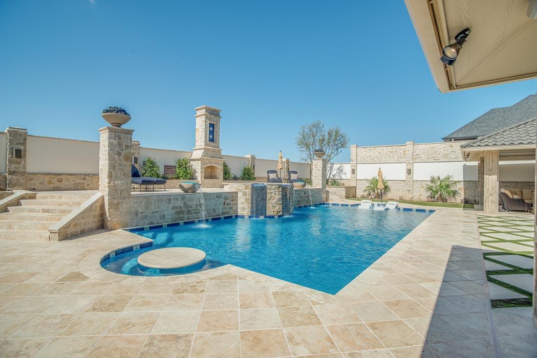 Pool and patio area in beautiful custom home.