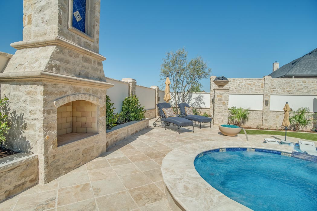 Amazing patio and pool area of custom home, complete with outdoor fireplace.