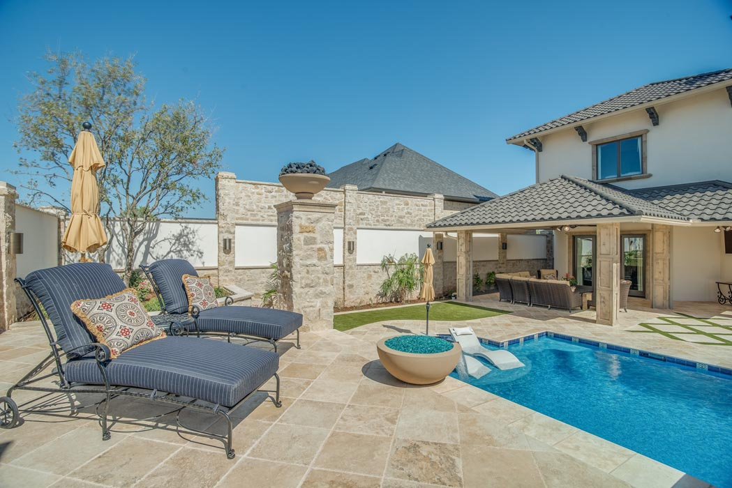 Soothing patio area with cozy lounge area, in grounds of custom home in Lubbock.