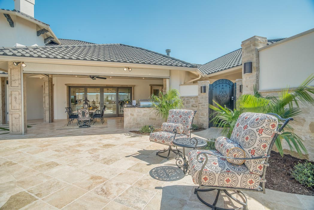 Spacious lounging area in patio of custom home in Lubbock.
