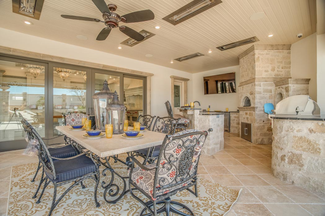 Spacious outdoor dining area adjacent to custom home in Lubbock