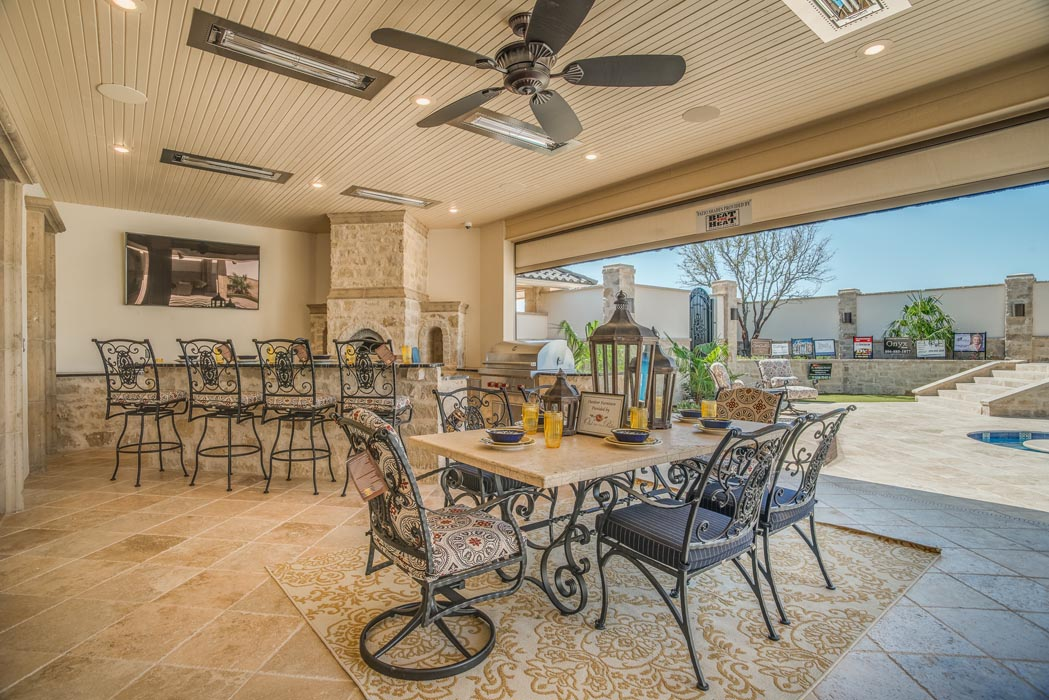 Custom outdoor dining space, perfect for entertaining, in custom home.