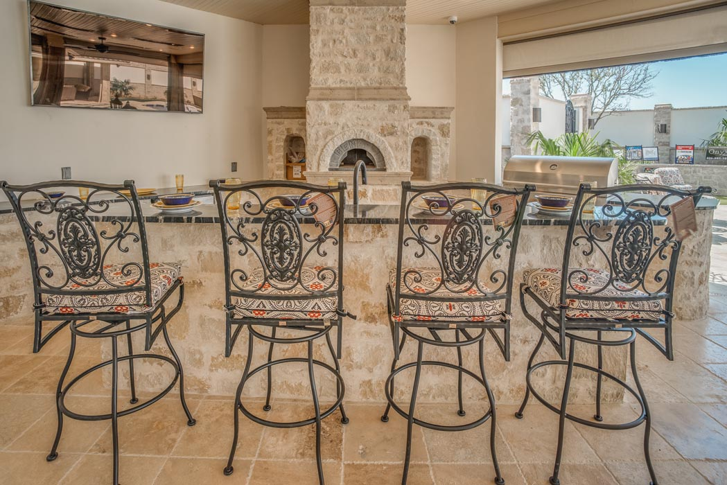 Enjoyable, pleasant outdoor dining area in yard area of custom home.