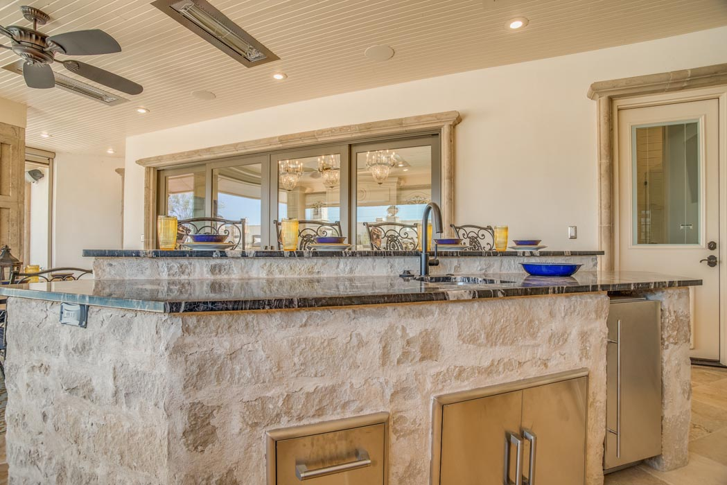 Work island of outdoor kitchen, in spacious patio entertaining area of custom home in Lubbock.