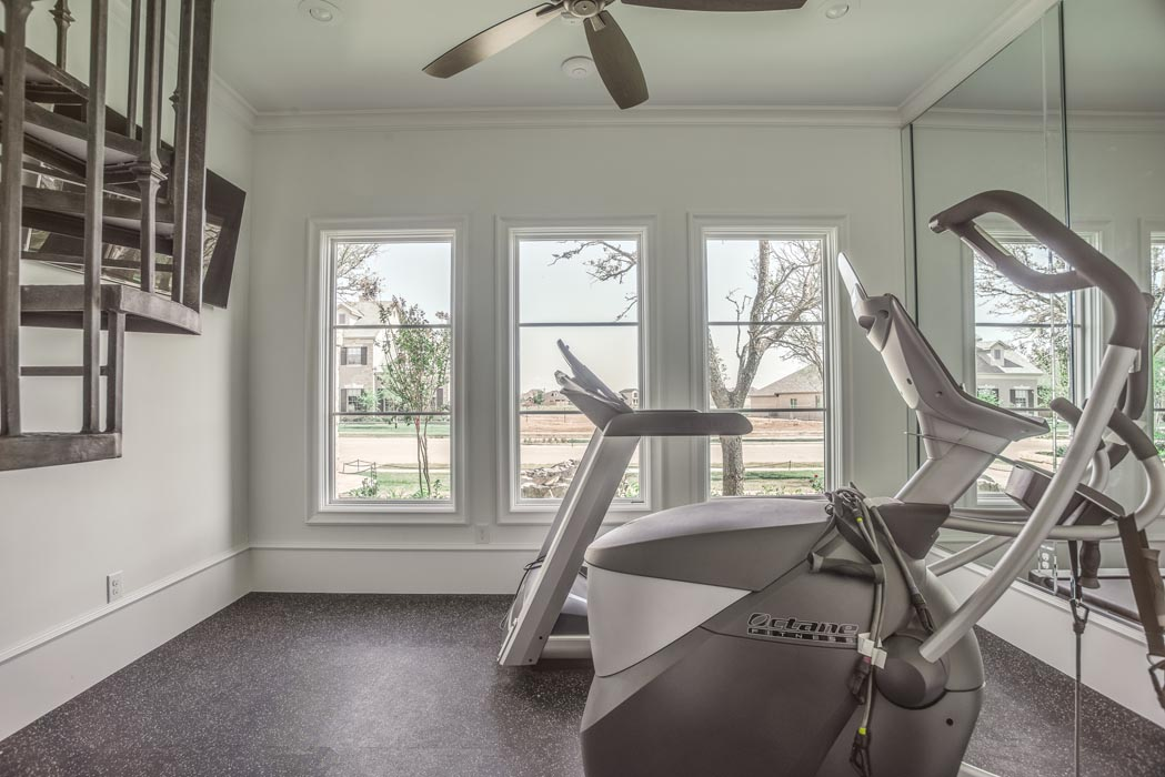 Workout-exercise room in beautiful custom home built by Sharkey Custom Homes in Lubbock, Texas.