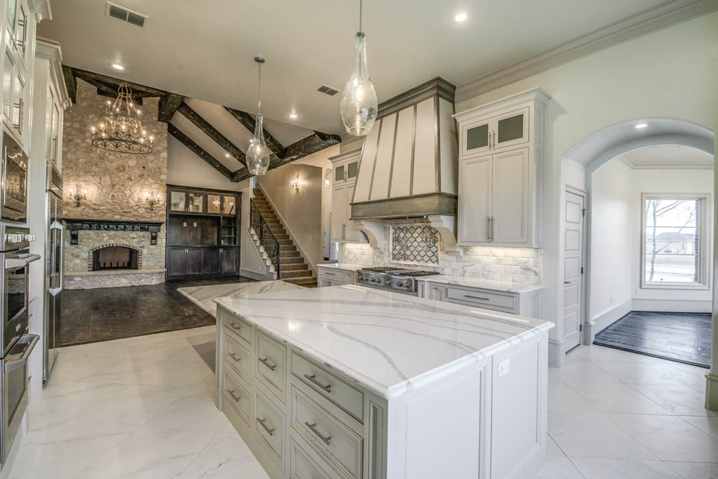 Custom home kitchen in Lubbock, Texas with back stairway.