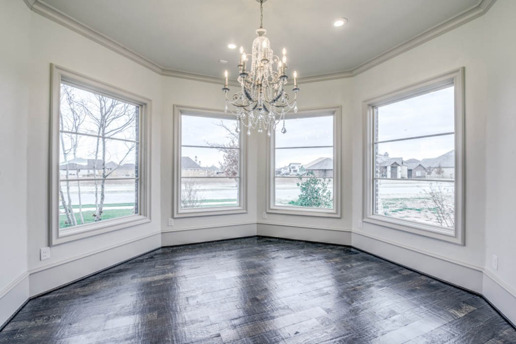 Round turret-style dining room in custom home.