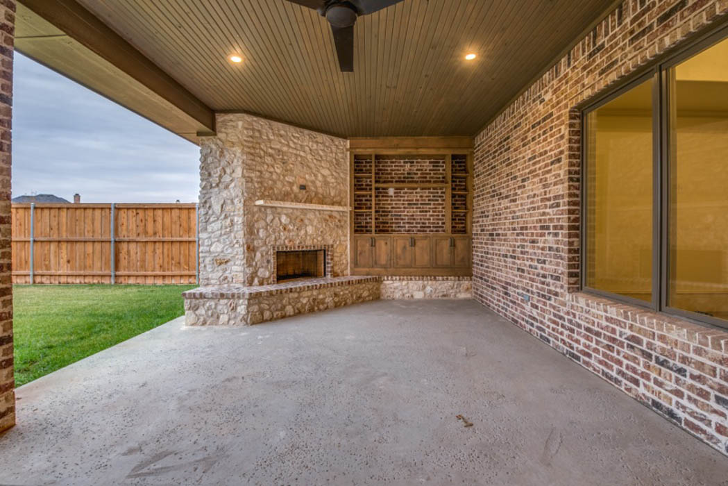 Outdoor fireplace in Lubbock custom home.
