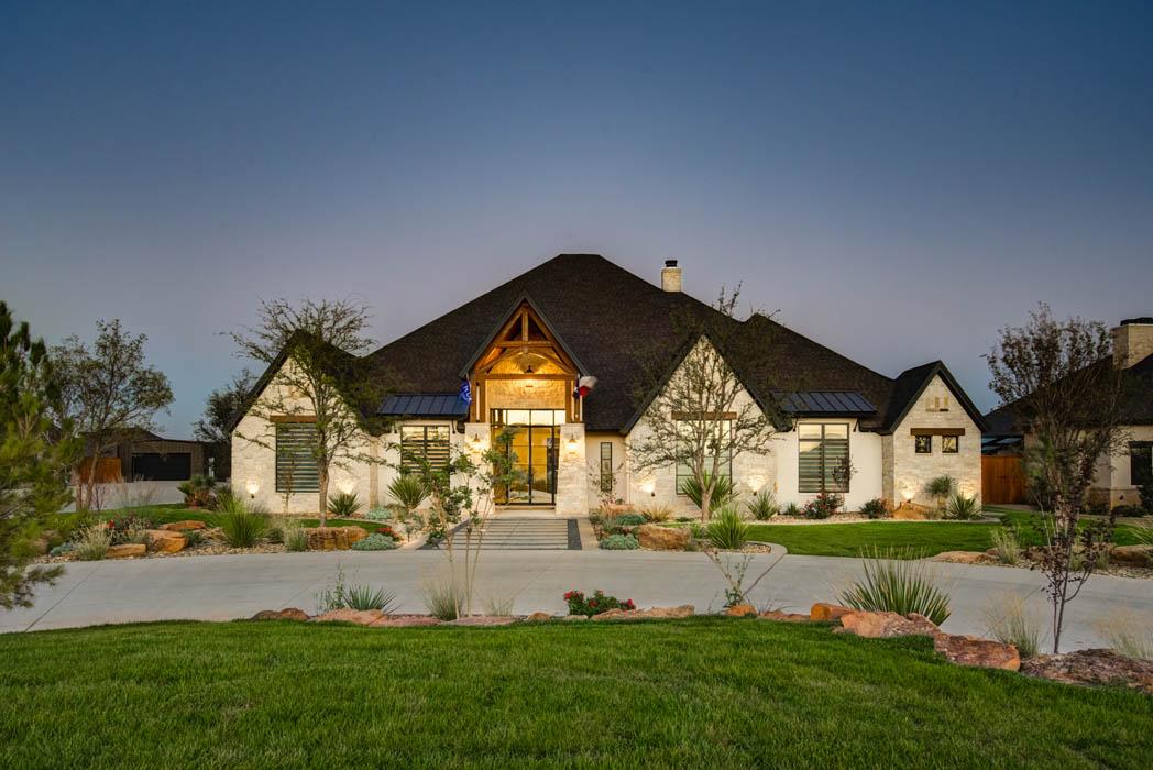 Exterior evening view of beautiful custom home near Lubbock, Texas.