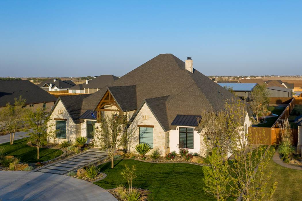 Long view of beautiful custom home built near Lubbock, Texas.