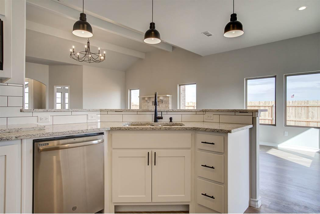 Kitchen island in beautiful new home for sale by Sharkey Custom Homes, Lubbock, Texas.