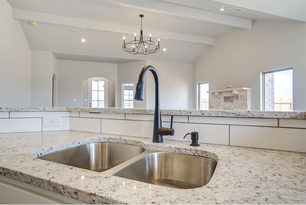 Detail of kitchen sink island in new home for sale in Lubbock.