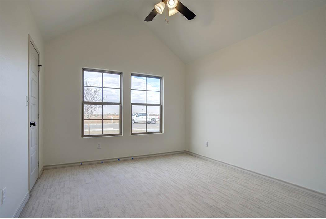 Bedroom with vaulted ceiling in new home for sale in Lubbock.