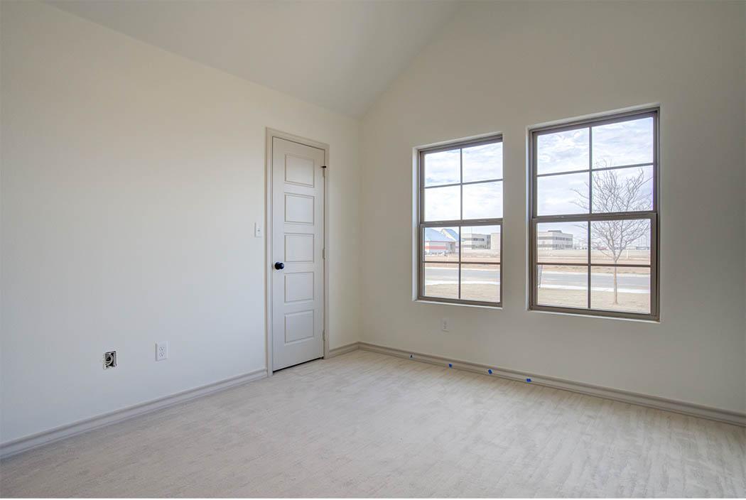 View of bedroom windows and closet door in new home for sale in Lubbock.