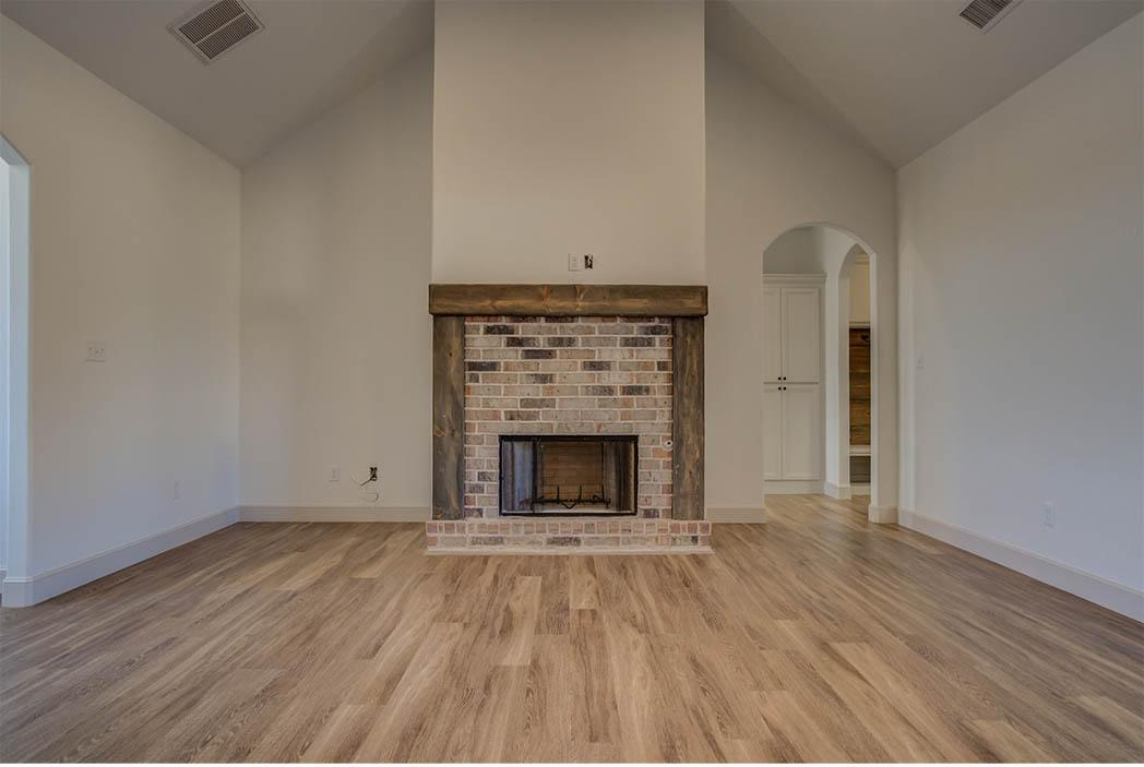 Living area fireplace in home for sale in Lubbock, Texas.