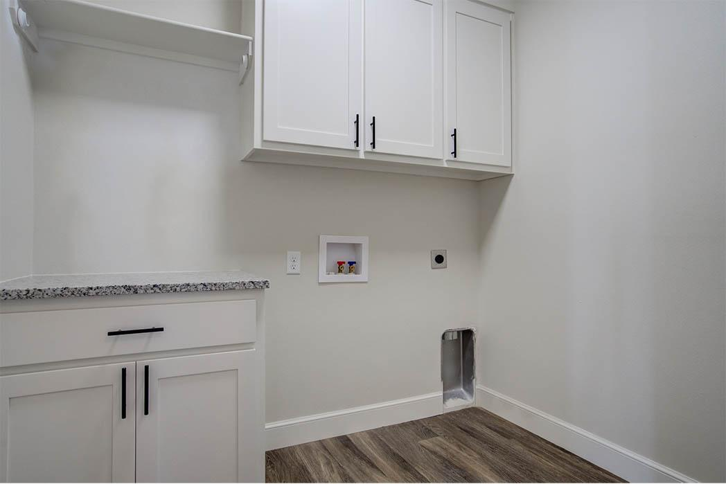Spacious laundry room in home for sale in Lubbock.
