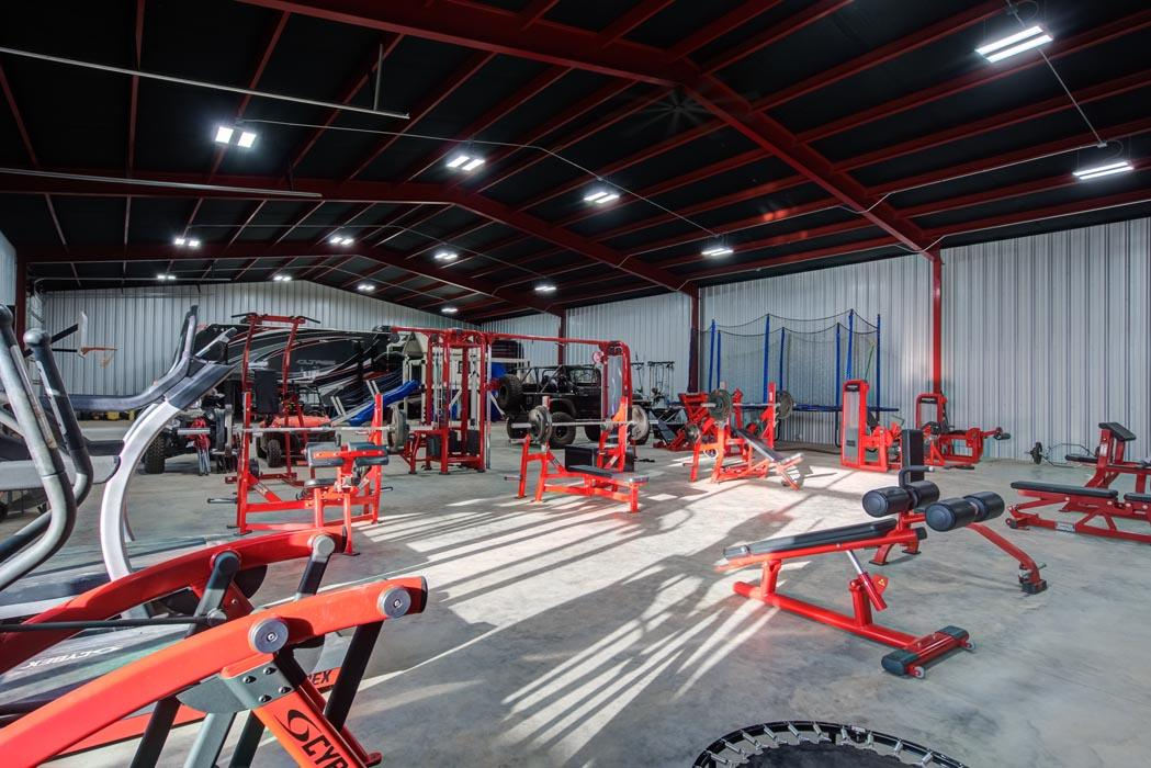 Example workout-exercise gym in beautiful new home built by Sharkey Custom Homes in Lubbock, Texas.