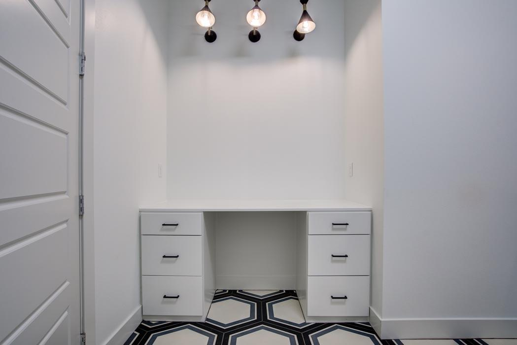 Laundry room area in new home in Lubbock, with special built-in workspaces.