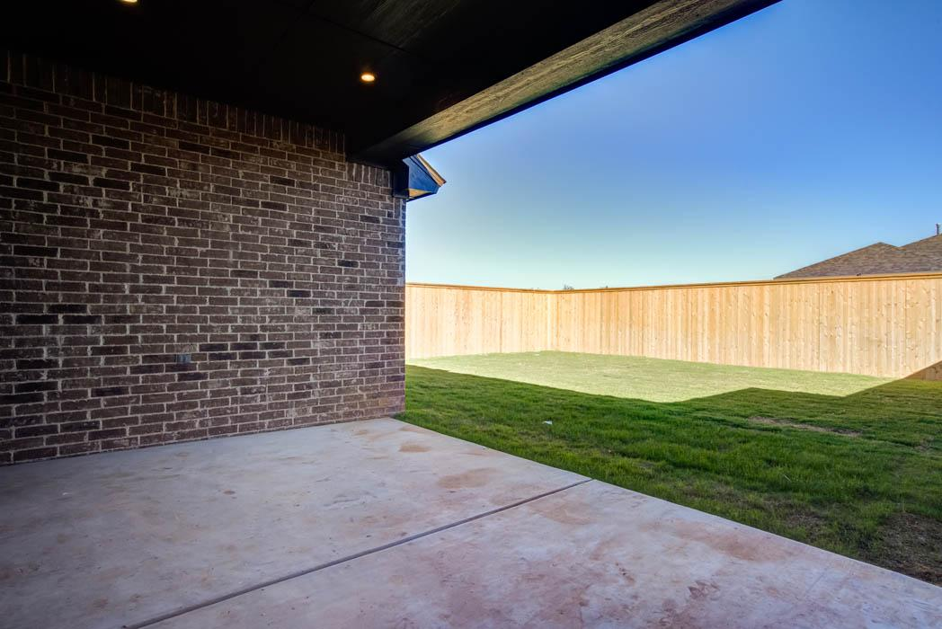 Great patio and spacious back yard in new Lubbock home for sale.