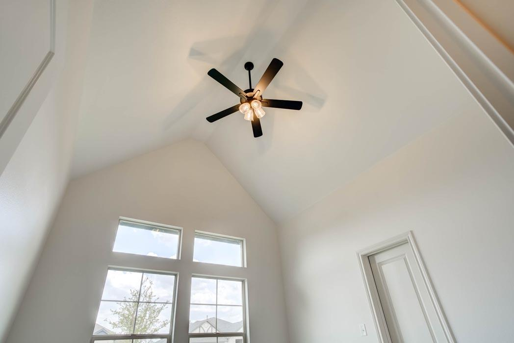 Spacious bedroom with vaulted ceiling in new home for sale in Lubbock, Texas.