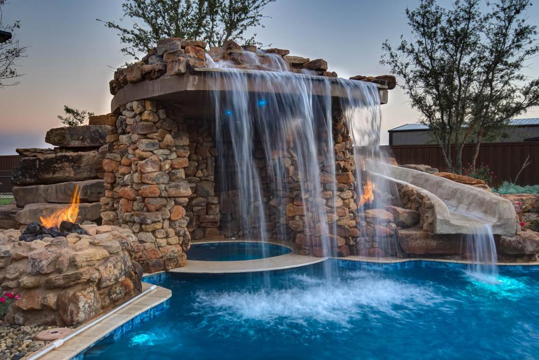Closer view of waterfall in custom home's amazing pool, near Lubbock.