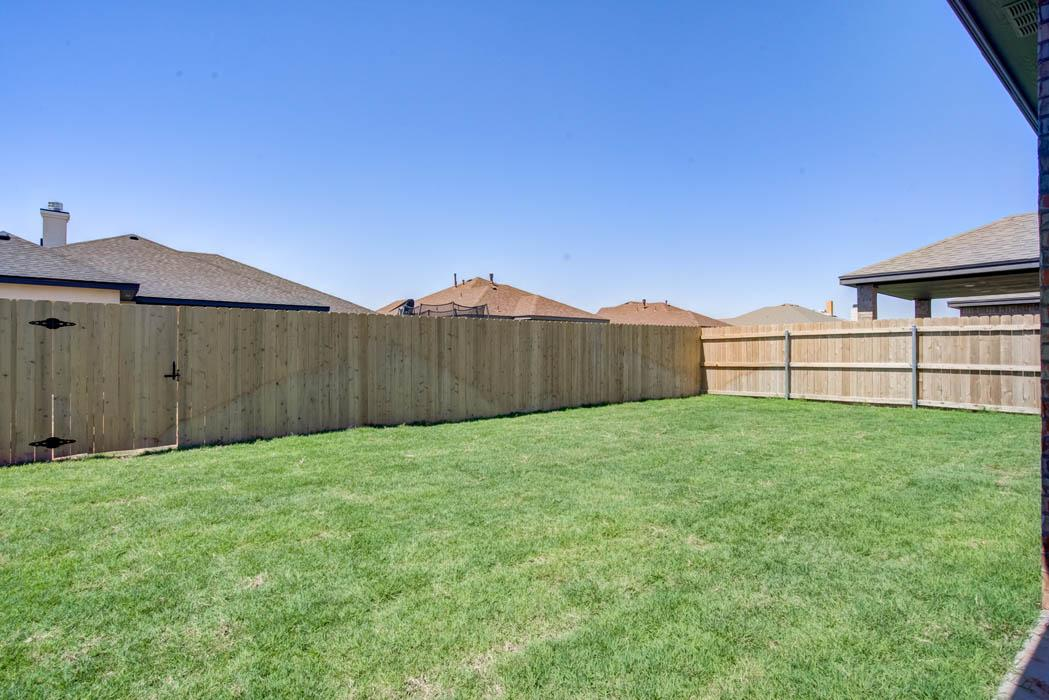 View of large backyard in home for sale in Lubbock.