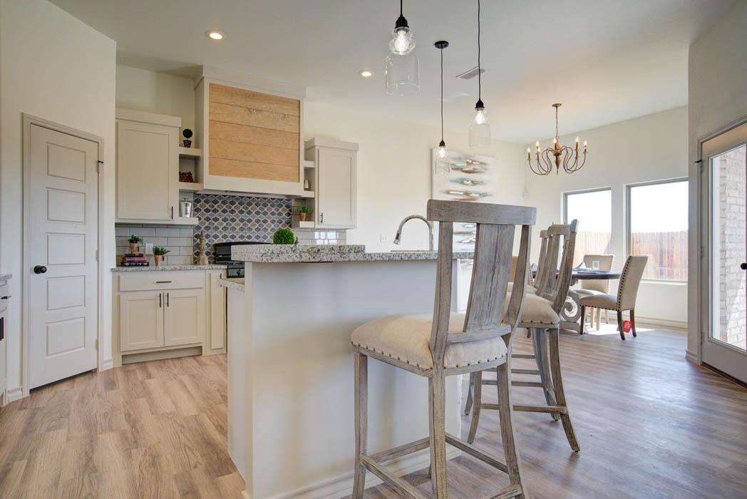 Spacious kitchen with island in new home for sale in Lubbock, Texas.