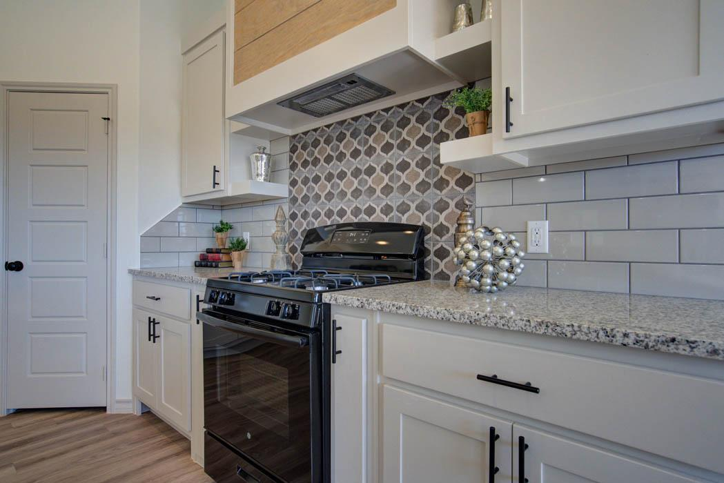 Close view of stove area in beautiful new home for sale in Lubbock, Texas.