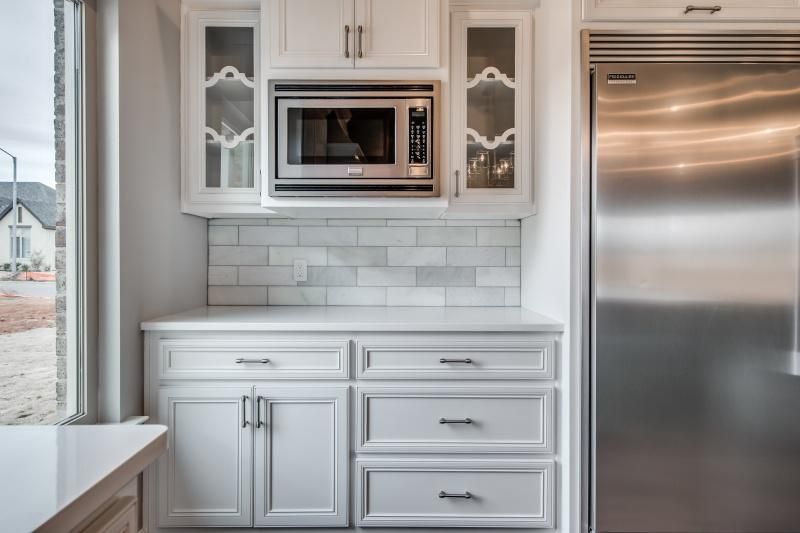 Microwave station in custom home kitchen.
