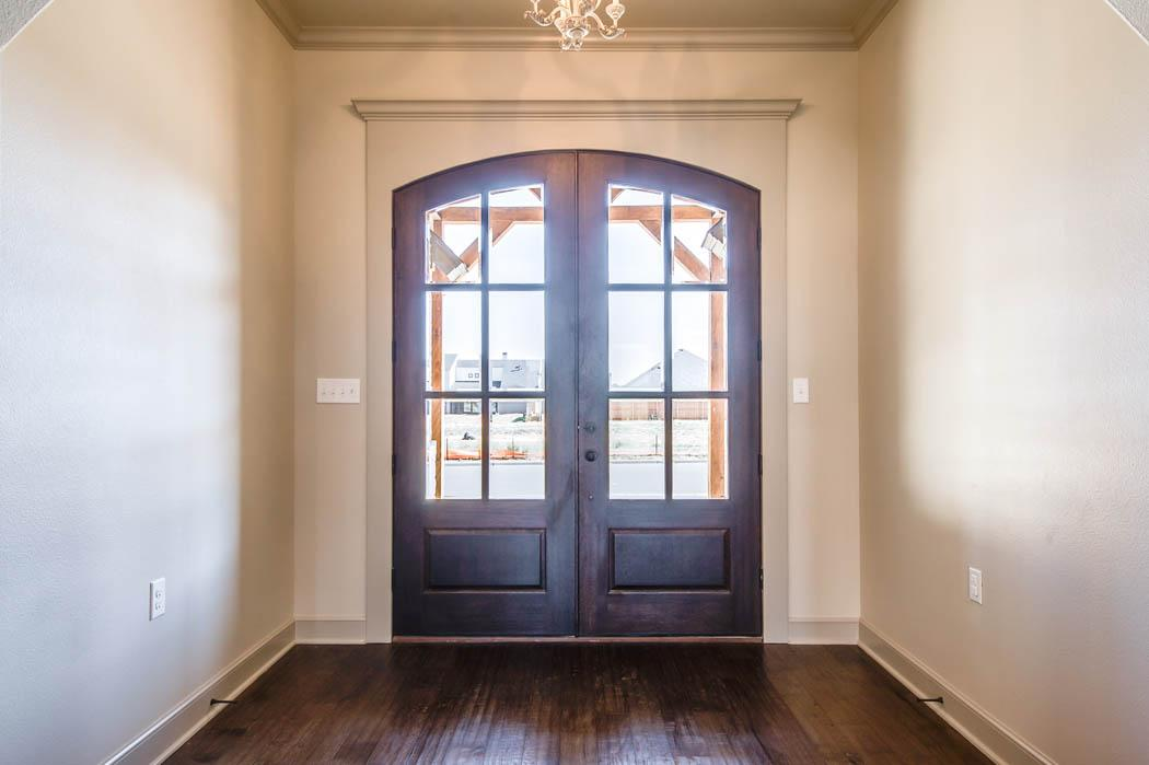 Beautiful entry with detailed doors in Lubbock, Texas home.