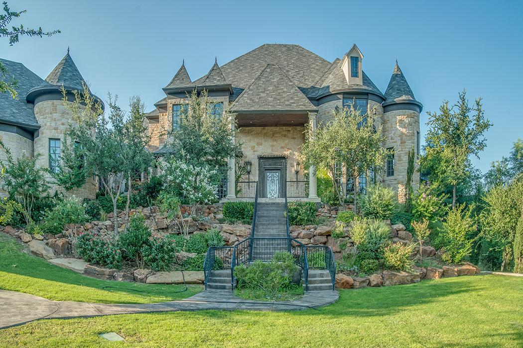 Beautiful exterior of custom home that looks like a castle.