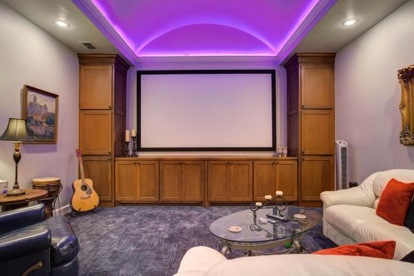 Spacious home theatre room with amazing mood lighting, in Lubbock custom home.