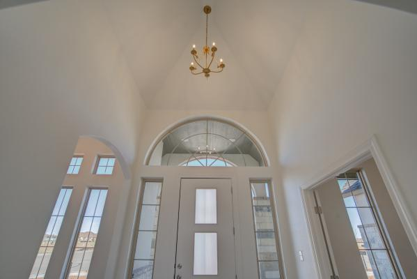Amazing entry in custom home by Sharkey Custom Homes.