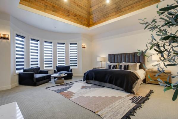 Spacious master bedroom with beautiful vaulted ceiling in custom home near Lubbock, Texas.