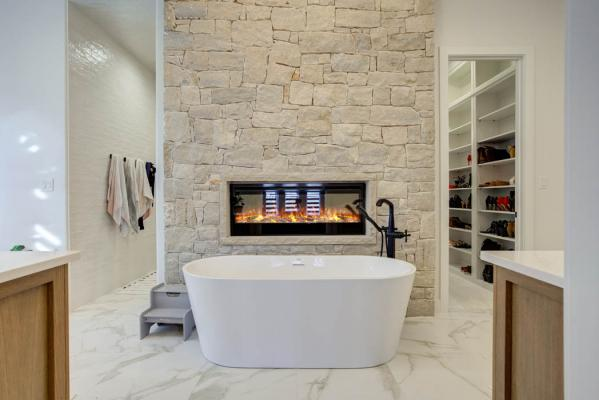 Stunning master bath with specialty bathtub and fireplace.