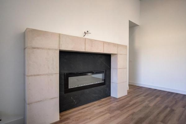 View of fireplace in beautiful Lubbock home built by Sharkey Custom Homes.