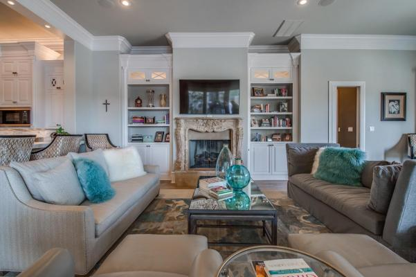 Spacious living area with wonderful details in home by Sharkey Custom Homes.