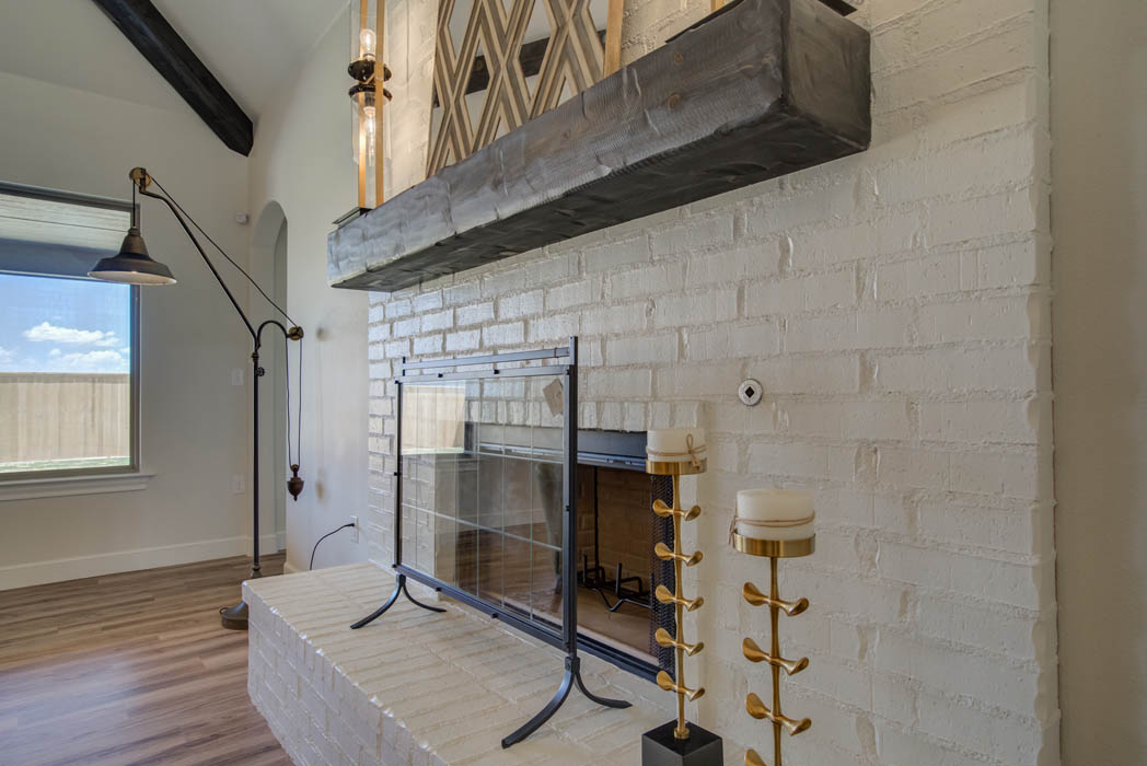 Fireplace in living room of beautiful West Texas home.