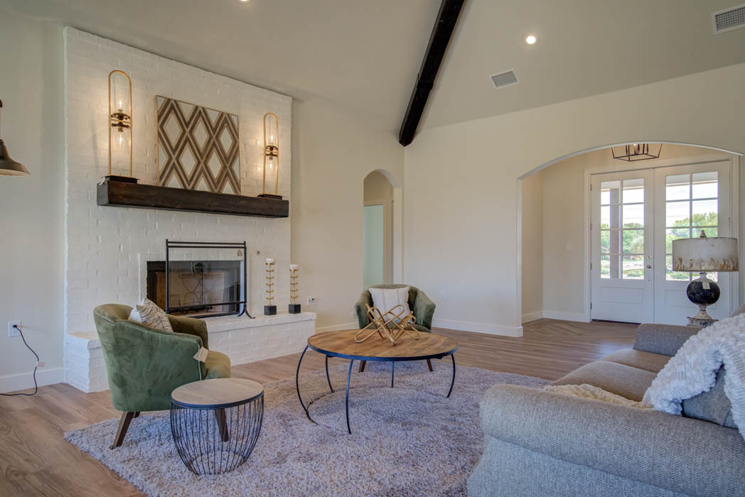 Spacious living room with beautiful entry and cozy fireplace in Lubbock, Texas home.