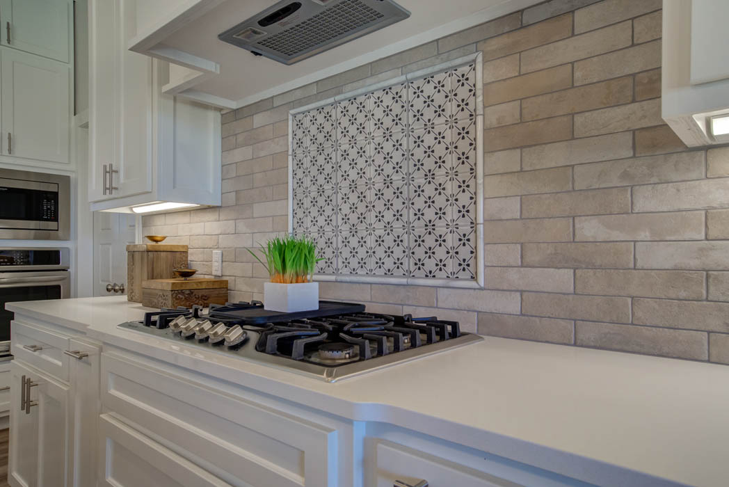 Detail of beautiful kitchen backsplash by stove in Lubbock, Texas home.
