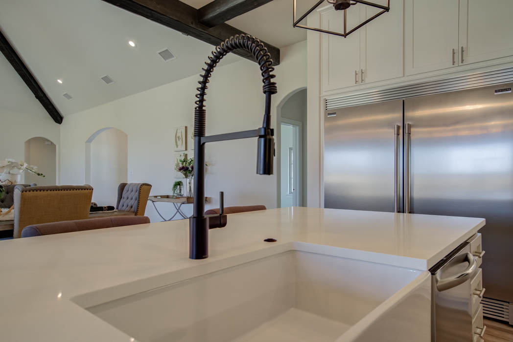 Detail of beautiful kitchen sink & faucet in Lubbock, Texas home.