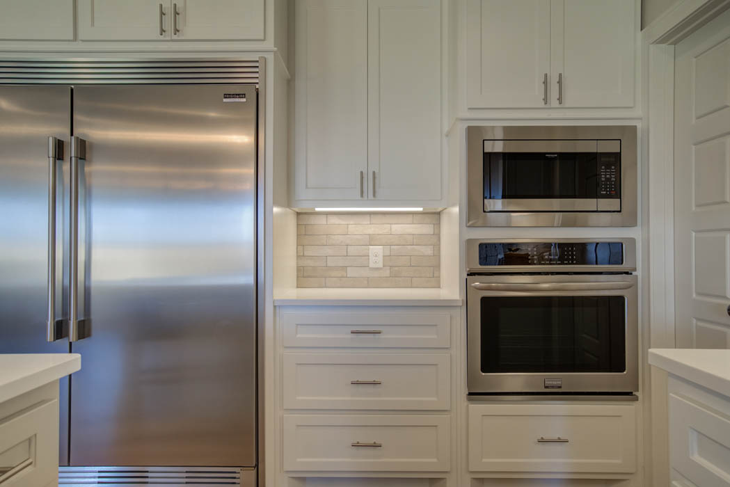 Detail of beautiful kitchen double oven & refrigerator in Lubbock, Texas home.