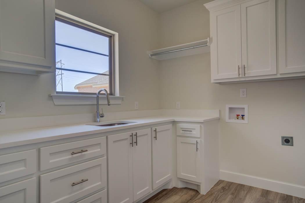Spacious laundry room in custom home.
