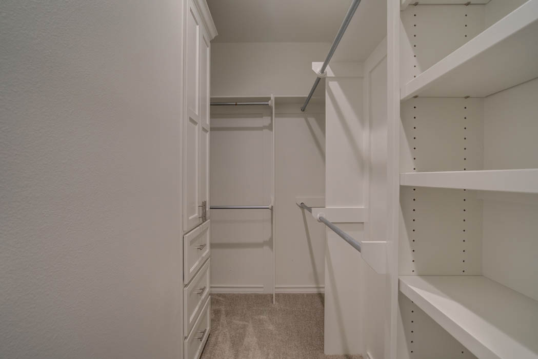 Spacious master bedroom closet in Lubbock home.