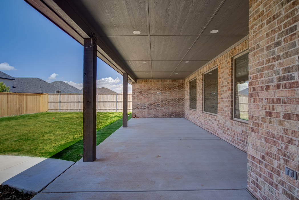 Spacious back patio in Lubbock, Texas home.