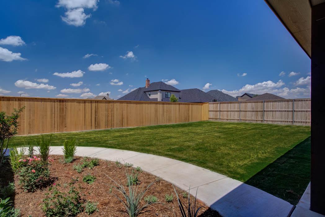 Spacious back yard in Lubbock, Texas home.